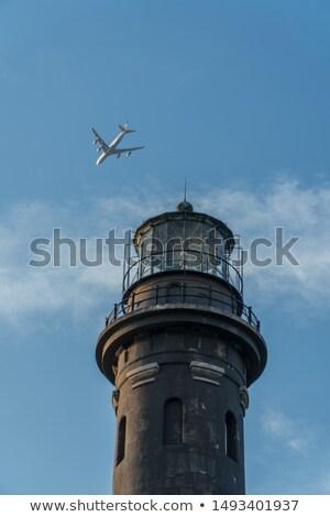 Маяк острове самолет Flying небе океана Сток-фото © ajlber