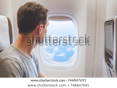 man looking at an airplane stock photo © photography33
