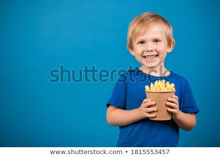 Közelkép fiú tart papír gyermek háttér Stock fotó © zzve