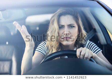 Zangado feminino motorista retrato Foto stock © ichiosea
