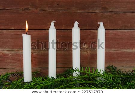 candle at old barn wall and green decoration stock photo © olandsfokus
