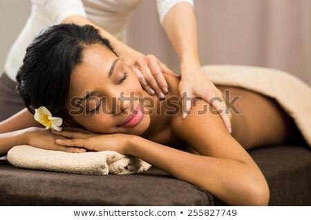 african woman receiving back massage stock photo © dash