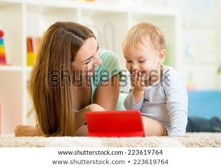 Stock photo: Toddler playing with Tablet