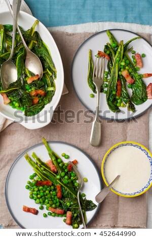 Baked Salad Green Peas Bacon And Mayonnaise Stok fotoğraf © zoryanchik