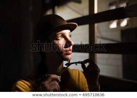 Figyelmes női zsoké másfelé néz istálló áll Stock fotó © wavebreak_media