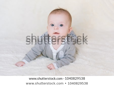 baby in the body lying on his stomach on a white background and  Stock photo © Traimak