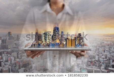 woman holding digital tablet stock photo © wavebreak_media
