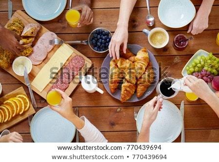 Stok fotoğraf: Adam · oturma · kahvaltı · tablo