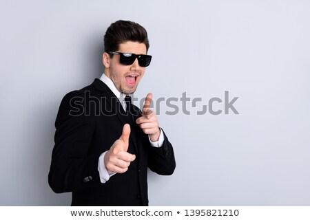 portrait of joyful young man in black tuxedo smiling stock photo © feedough