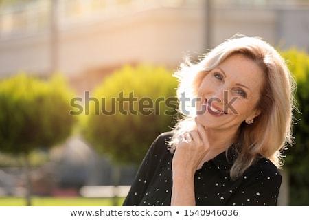 Senior woman in autumn park. Stock photo © NeonShot