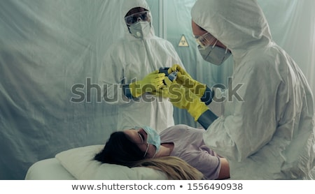Doctor and two patients in the field Stock photo © colematt