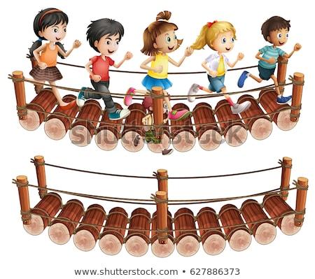 children running across the wooden bridge stock photo © colematt