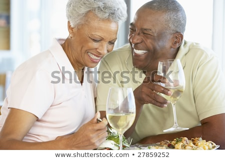 image of cheerful african american couple in colorful clothes sh stock photo © deandrobot