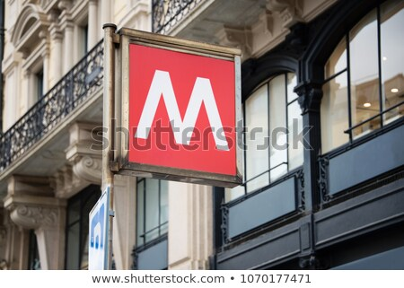 Traditional Milan metro sign on the backdrop of a beautiful old  Stock photo © boggy