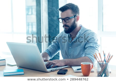 male creative worker with laptop at office Stock photo © dolgachov