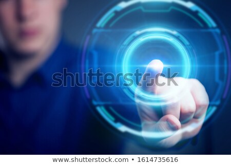 a hand presses a virtual button stock photo © stoonn