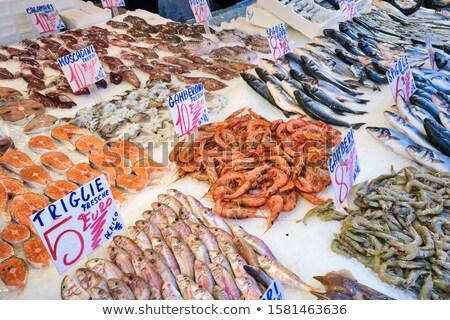 Salmon, prawns and other fish for sale Stock photo © elxeneize