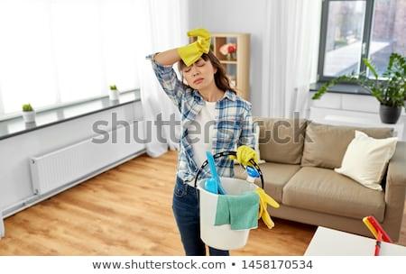 Cansado mulher balde limpeza casa pessoas Foto stock © dolgachov