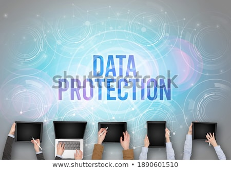 Group of people in front of a laptop, security concept Stock photo © ra2studio