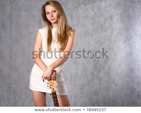 Female leaning on her electric guitar Stock photo © lovleah
