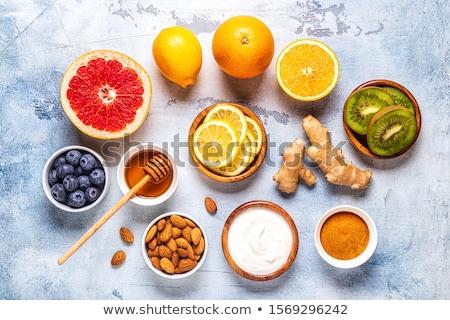 Blueberries, grapefruit and lemon yogurt Stock photo © fotogal
