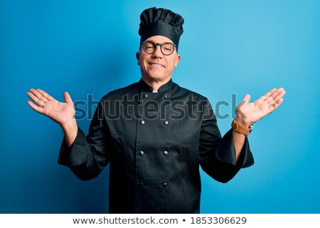 Grey-haired man choosing food in restaurant Stock photo © photography33