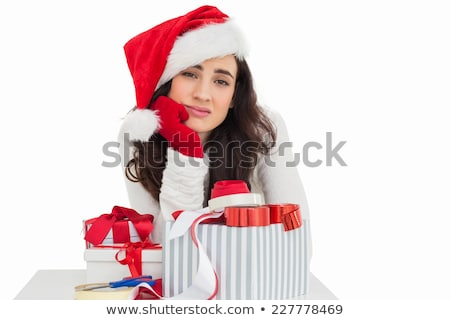 Stock photo: young woman is packing  present for christmas isolated