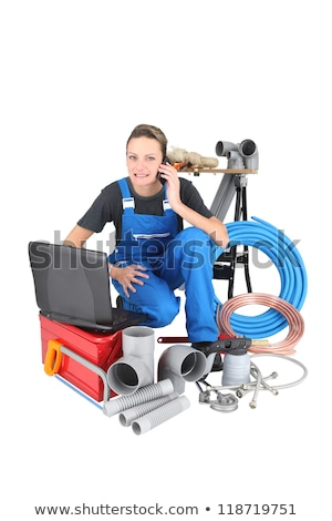 Tradeswoman surrounded by building materials and technology Stock photo © photography33
