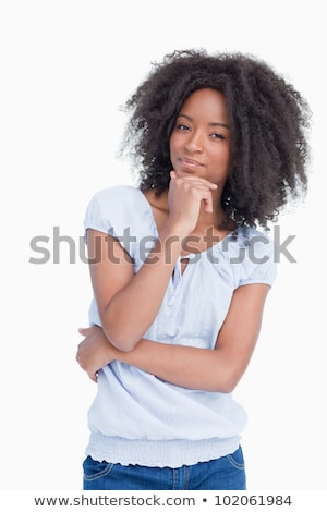 Young woman considering against a white background Stock photo © wavebreak_media