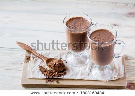 two glasses latte macchiato with chocolate powder Stock photo © Rob_Stark