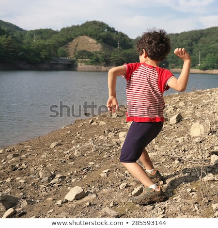 Boy on Rocks at a River Stock photo © 2tun