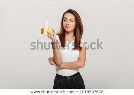 Pretty girl with banana isolated on white. stock photo © kyolshin