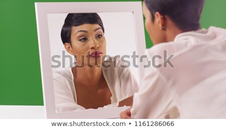 Portrait of a lovely woman reflected in the mirror Stock photo © alekleks