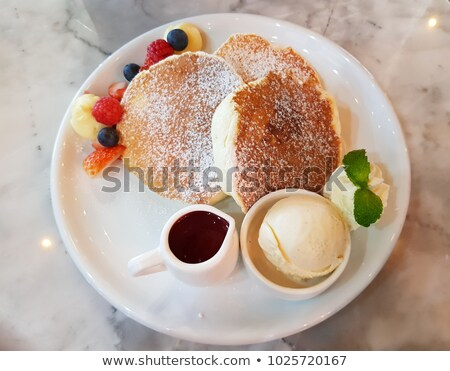 tasty sweet pancakes with vanilla icecream and topping Stock photo © juniart