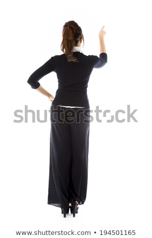 Rear view of an Indian young woman pretending to working on virtual screen Stock photo © bmonteny