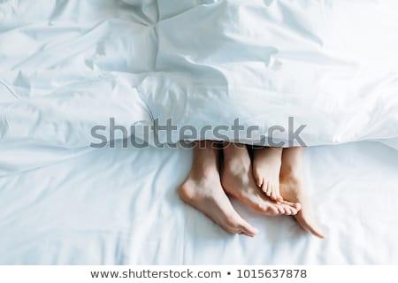 Feet on bedding Stock photo © simply