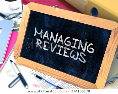 Managing Reviews Handwritten by White Chalk on a Blackboard. Stock photo © tashatuvango