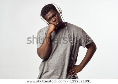 cool fashion man sitting and putting on his sunglasses  Stock photo © feedough