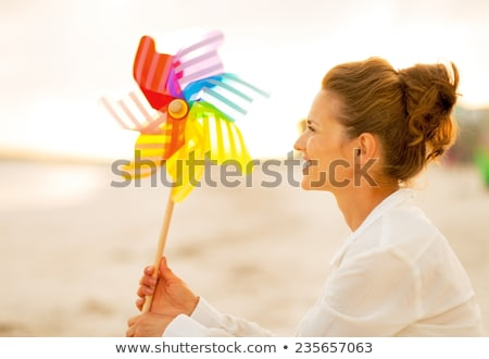Young woman with pinwheel Stock photo © IS2