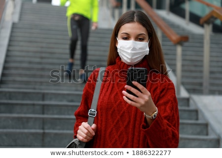 woman or student with smartphone at office stairs Stock photo © dolgachov