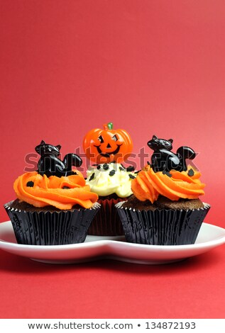 halloween party cupcakes with decorations on plate stock photo © dolgachov