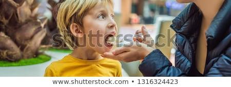 boy at the airport   young boy eating food while waiting for his stock photo © galitskaya
