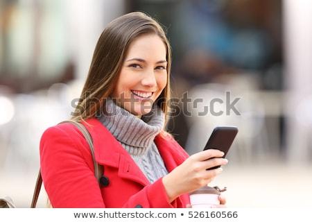 Сток-фото: красивой · деловой · женщины · позируют · улице · улице · используя · ноутбук