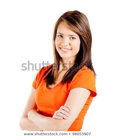 young woman or teenage girl in orange t-shirt Stock photo © dolgachov