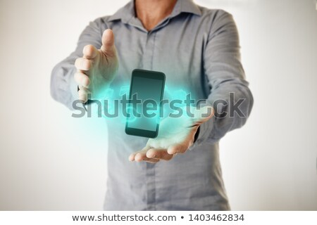 hands with application icons between. Futuristic. Stock photo © wavebreak_media