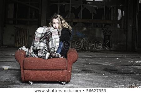 Triste fille minable canapé séance rouge Photo stock © lichtmeister