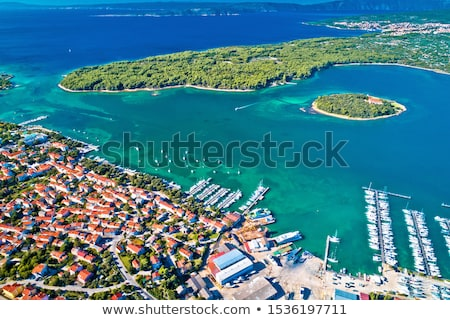 Punat. Town of Punat and monastery island of Kosljun aerial view stock photo © xbrchx