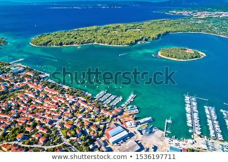 Punat. Town of Punat and monastery island of Kosljun aerial view stock photo © xbrchx