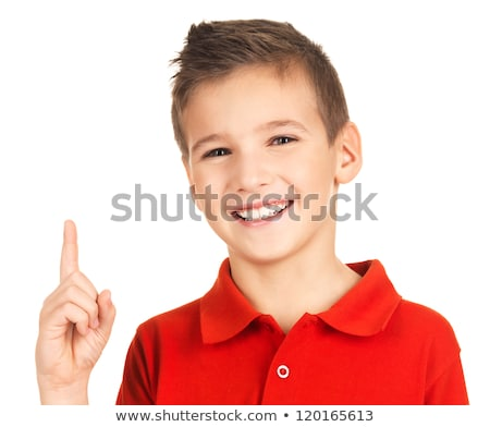 happy boy pointing finger up stock photo © bluering