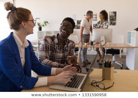 Widok z boku młodych różnorodny działalności koledzy Zdjęcia stock © wavebreak_media